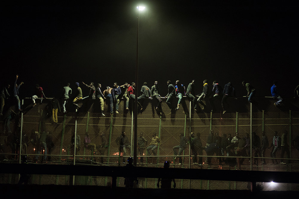 Melilla, Spain - August 13th 2014 - More than 100 sub saharian immigrants try to cross the fence between Spain and Morocco.