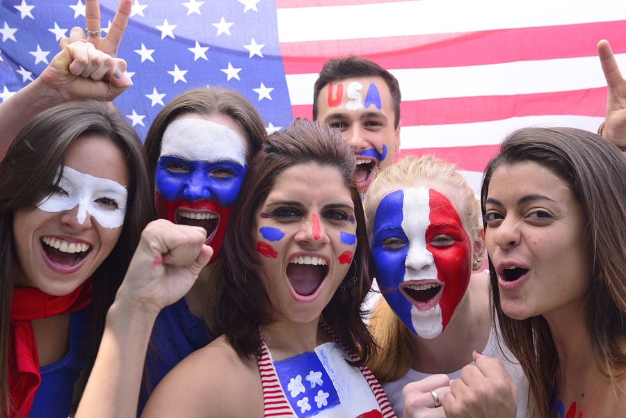 Group of happy USA soccer fans commemorating victory yelling.